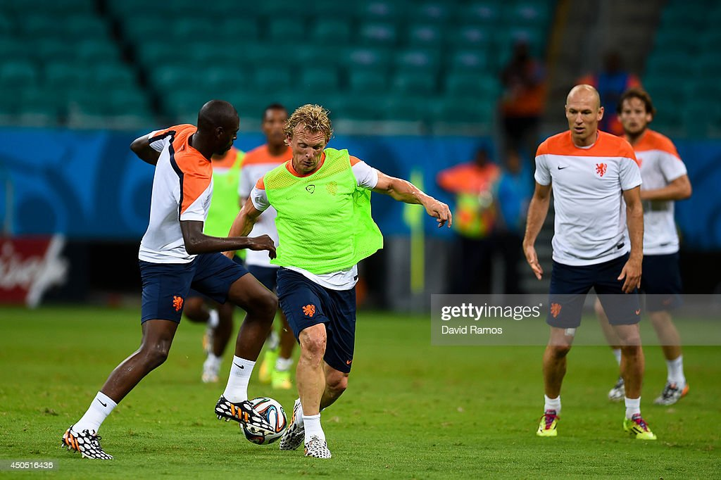 Dirk Kuyt of Netherlands duels for the ball with Bruno Martins Indi of Netherlands during the Netherlands training session before the 2014 FIFA Word Cup Group B match between Spain and Netherlands at the Arena Fonte Nova on June 12, 2014 in Salvador, Brazil.