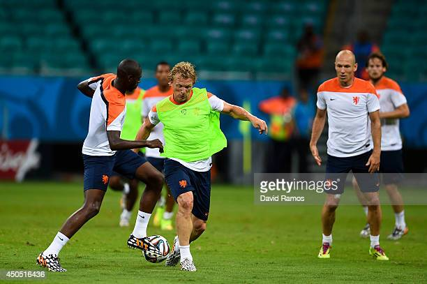 Dirk Kuyt of Netherlands duels for the ball with Bruno Martins Indi of Netherlands during the Netherlands training session before the 2014 FIFA Word...