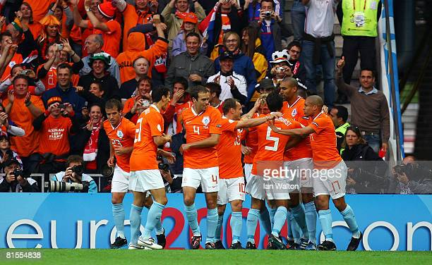 Dirk Kuyt of Netherlands is congratulated by team mates after scoring the opening goal during the UEFA EURO 2008 Group C match between Netherlands...