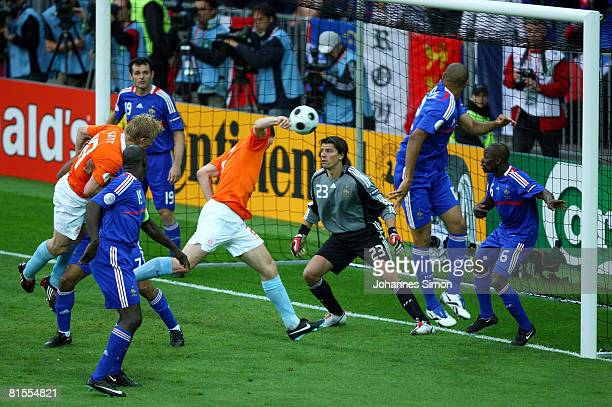 Dirk Kuyt of Netherlands scores a header during the UEFA EURO 2008 Group C match between Netherlands and France at Stade de Suisse Wankdorf on June...