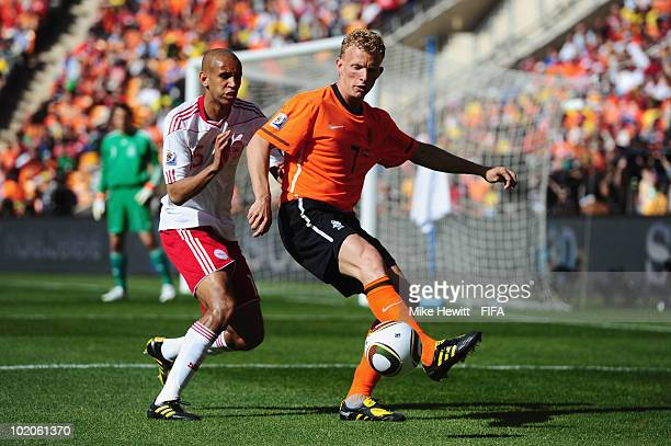 Dirk Kuyt of the Netherlands is challenged by Simon Poulsen of Denmark during the 2010 FIFA World Cup Group E match between Netherlands and Denmark...