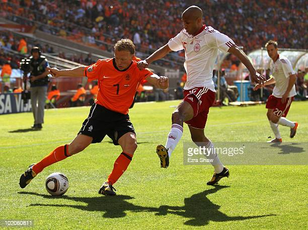 Dirk Kuyt of the Netherlands is tackled by Simon Poulsen of Denmark during the 2010 FIFA World Cup Group E match between Netherlands and Denmark at...