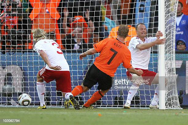 Dirk Kuyt of the Netherlands scores from the rebound after the ball hits the post during the 2010 FIFA World Cup Group E match between Netherlands...