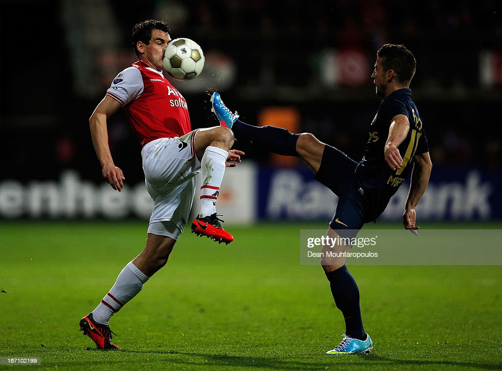Dirk Marcellis of AZ and Dries Mertens of PSV battle for the ball during the Eredivisie match between AZ Alkmaar and PSV Eindhoven at the AFAS Stadium on April 20, 2013 in Alkmaar, Netherlands.