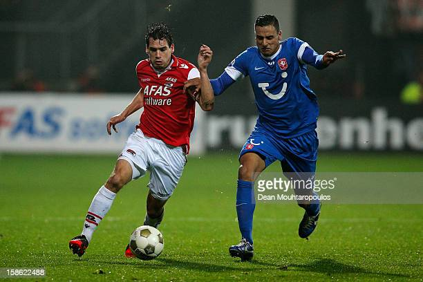 Dirk Marcellis of AZ and Nacer Chadli of Twente in action during the Eredivisie match between AZ Alkmaar and FC Twente at the AFAS Stadium on...