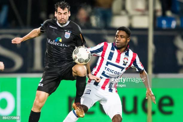 Dirk Marcellis of PEC Zwolle Bartholomew Ogbeche of Willem II during the Dutch Eredivisie match between Willem II Tilburg and PEC Zwolle at Koning...