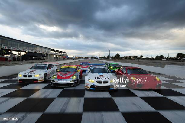 Dirk Muller of Germany drives the and Tommy Milner drives the BMW Rahal Letterman Racing BMW M3 Jorg Bermeister of Germany drives the and Seth Neiman...