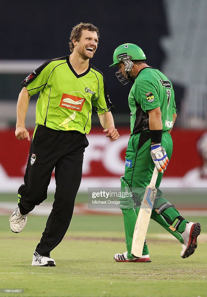 Dirk Nannes (L) of The Sydney Thunder celebrates his dismissal of Brad Hodge during the Big Bash League match between the Melbourne Stars and the Sydney Thunder at Melbourne Cricket Ground on January 8, 2013 in Melbourne, Australia.