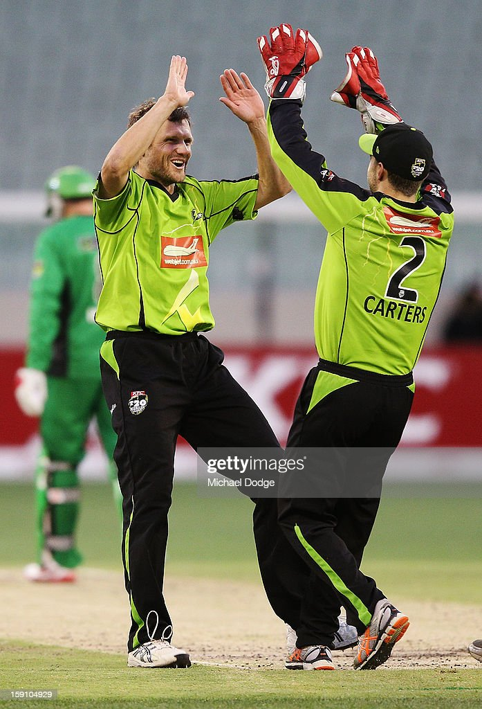 Dirk Nannes (L) of The Sydney Thunder celebrates his dismissal of Brad Hodge with teamate Ryan Carters during the Big Bash League match between the Melbourne Stars and the Sydney Thunder at Melbourne Cricket Ground on January 8, 2013 in Melbourne, Australia.