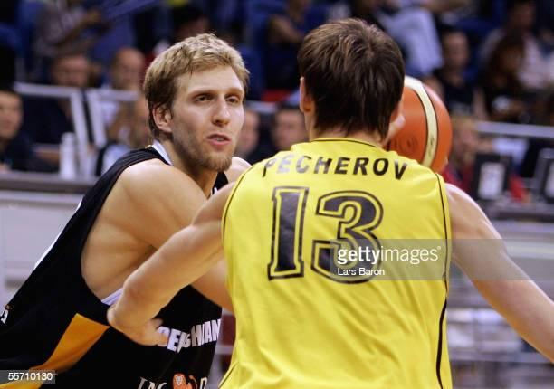 Dirk Nowitzk of Germany in action with Oleksiy Pecherov of Ukraine during the FIBA EuroBasket 2005 match between Ukraine and Germany on September 17...