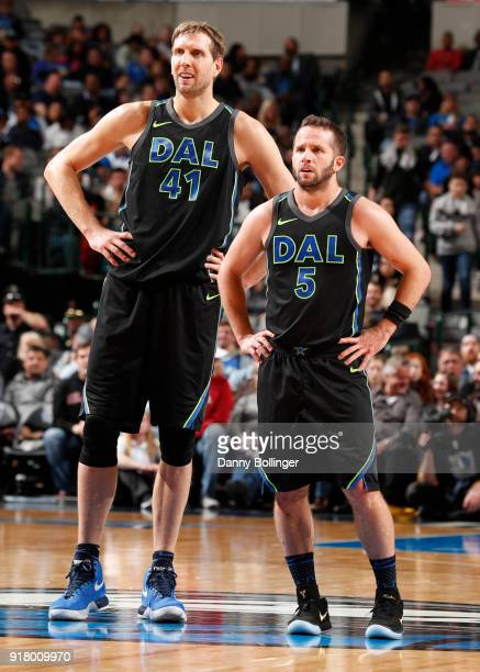 Dirk Nowitzki and JJ Barea of the Dallas Mavericks look on during game against the Sacramento Kings on February 13 2018 at the American Airlines...