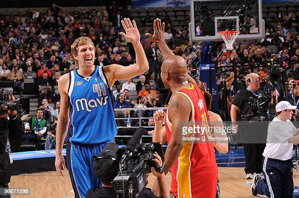 Dirk Nowitzki and Kenny Thomas of Team Texas congratulate each other during the Haier Shooting Stars Competition as part of All Star Saturday Night...