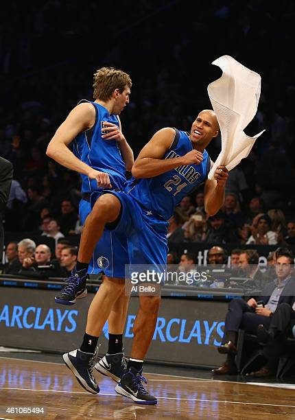 Dirk Nowitzki and Richard Jefferson of the Dallas Mavericks celebrate a 9688 overtime win against the Brooklyn Nets during their game at the Barclays...