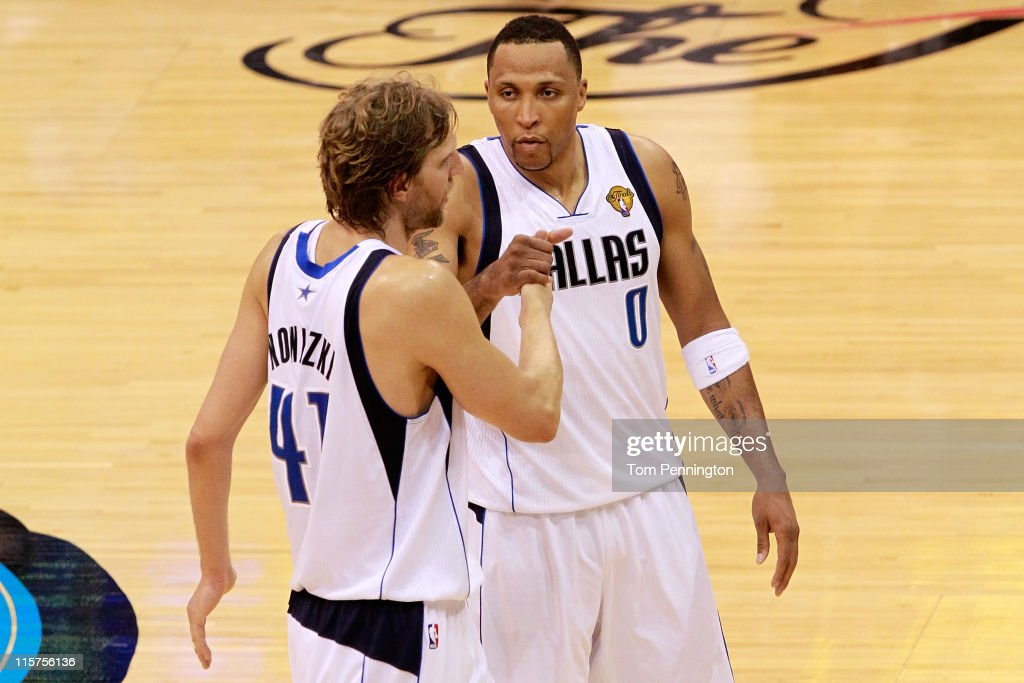 Dirk Nowitzki #41 and Shawn Marion #0 of the Dallas Mavericks celebrate their 112-103 win against the Miami Heat in Game Five of the 2011 NBA Finals at American Airlines Center on June 9, 2011 in Dallas, Texas.