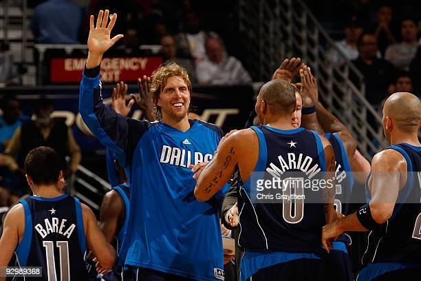 Dirk Nowitzki and Shawn Marion of the Dallas Mavericks celebrates during the game against the New Orleans Hornets at New Orleans Arena on November 4...