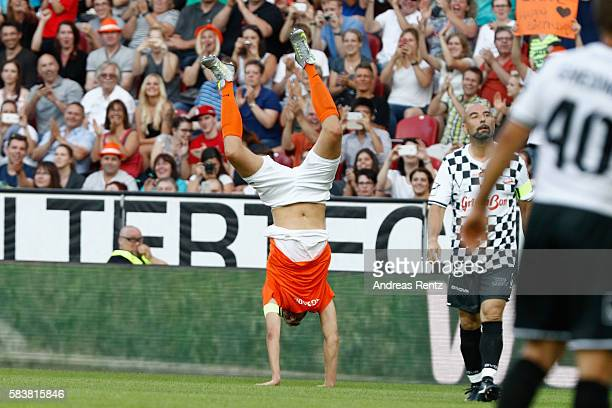 Dirk Nowitzki celebrates during the 'Champions for charity' football match between Nowitzki All Stars and Nazionale Piloti in honor of Michael...