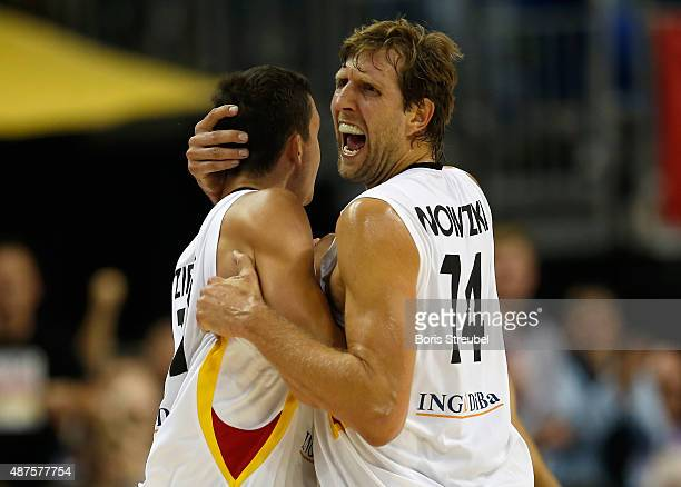 Dirk Nowitzki celebrates with team mate Paul Zipser of Germany during the FIBA EuroBasket 2015 Group B basketball match between Germany and Spain at...