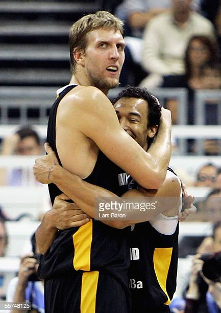 Dirk Nowitzki from Germany celebrates with team mate Demond Greene winning the FIBA EuroBasket 2005 quarter final match between Slovenia and Germany...