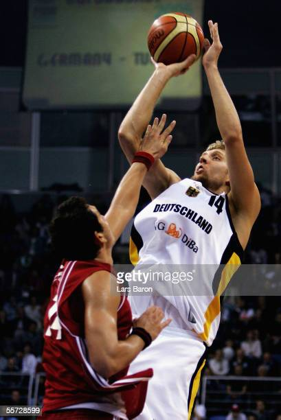 Dirk Nowitzki from Germany in action with Kaya Peker from Turkey during the FIBA EuroBasket 2005 elimination match between Germany and Turkey at the...