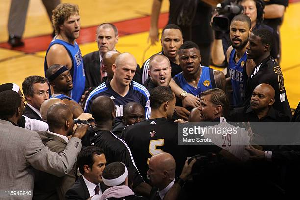 Dirk Nowitzki Jason Terry Brian Cardinal and DeShawn Stevenson of the Dallas Mavericks confront players from the Miami Heat including Juwan Howard on...