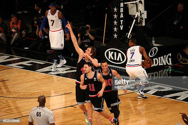 Dirk Nowitzki Klay Thompson and Stephen Curry of the Western Conference AllStars celebrate during the 2015 NBA AllStar Game as part of the 2015...