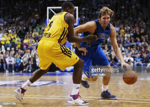 Dirk Nowitzki of Dallas is challenged by Deon Thompson of Berlin during the NBA Europe Live 2012 Tour match between Alba Berlin and Dallas Mavericks...