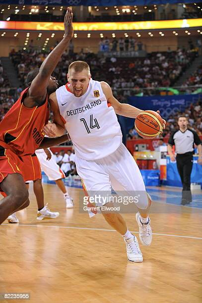 Dirk Nowitzki of Germany drives against Angola during day 2 of the men's preliminary basketball game at the 2008 Beijing Olympic Games at the Beijing...