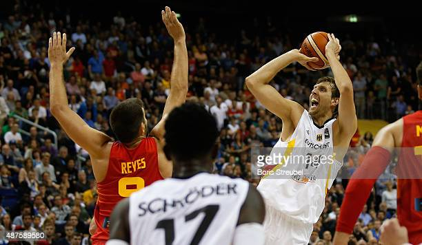 Dirk Nowitzki of Germany drives to the basket against Felipe Reyes of Spain during the FIBA EuroBasket 2015 Group B basketball match between Germany...