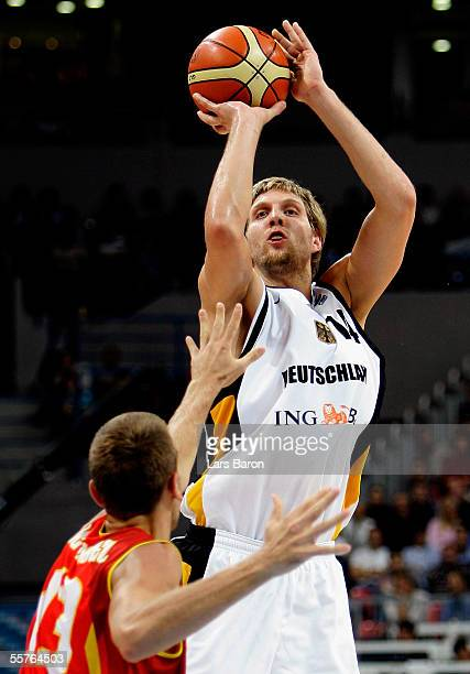 Dirk Nowitzki of Germany in action with Ignacio de Miguel of Spain during the FIBA EuroBasket 2005 semi final match between Germany and Spain on...