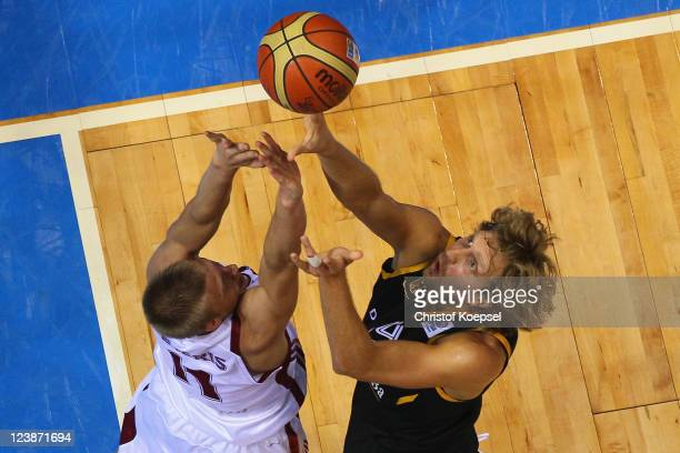 Dirk Nowitzki of Germany shoots over Mareks Mejeris of Latvia during the EuroBasket 2011 first round group B match between Latvia and Germany at...