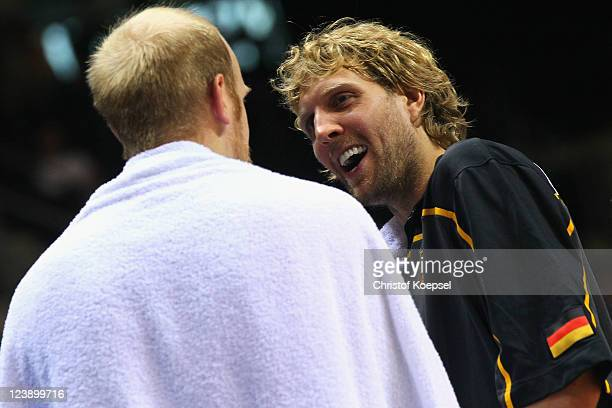 Dirk Nowitzki of Germany smiles at Chris Kaman of Germany during the EuroBasket 2011 first round group B match between Latvia and Germany at Siauliai...
