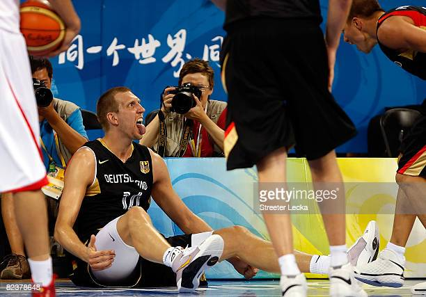 Dirk Nowitzki of Germany sticks out his tounge while taking on China during the group B preliminary basketball game at the Wukesong Indoor Stadium on...