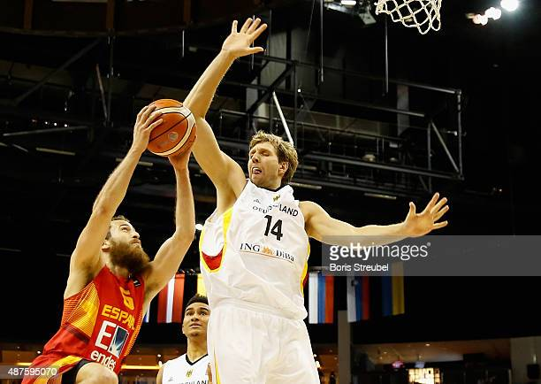 Dirk Nowitzki of Germany tries to block Sergio Rodriguez of Spain during the FIBA EuroBasket 2015 Group B basketball match between Germany and Spain...