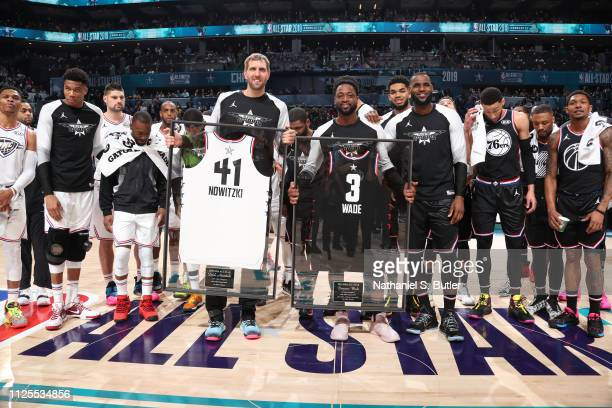 Dirk Nowitzki of Team Giannis and Dwyane Wade of Team LeBron are honored during the 2019 NBA AllStar Game on February 17 2019 at the Spectrum Center...