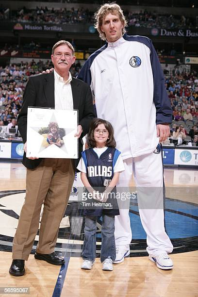 Dirk Nowitzki of the Dallas Mavericks accepts an award from the Make a Wish Foundation recognizing his financial contributions to the group during a...