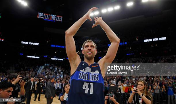 Dirk Nowitzki of the Dallas Mavericks acknowledges fans at the end of his last game against the San Antonio Spurs at ATT Center on April 10 2019 in...