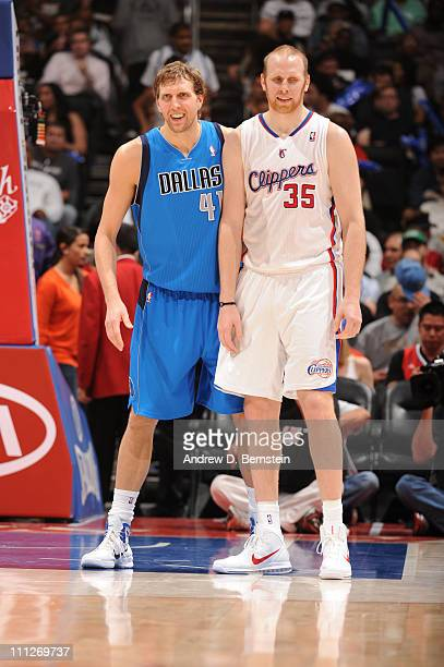 Dirk Nowitzki of the Dallas Mavericks and Chris Kaman of the Los Angeles Clippers share look on during their game at Staples Center on March 30 2011...