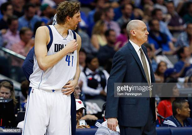 Dirk Nowitzki of the Dallas Mavericks and head coach Rick Carlisle of the Dallas Mavericks interact in the first half as the Mavericks take on the...