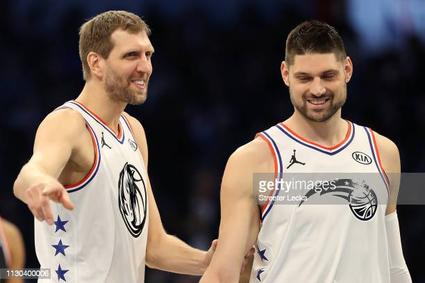 Dirk Nowitzki of the Dallas Mavericks and Team Giannis reacts talking with Nikola Vučević of the Orlando Magic as they take on Team LeBron in the...