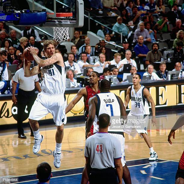 Dirk Nowitzki of the Dallas Mavericks attempts a shot against Udonis Haslem of the Miami Heat during Game Six of the 2006 NBA Finals played June 20...