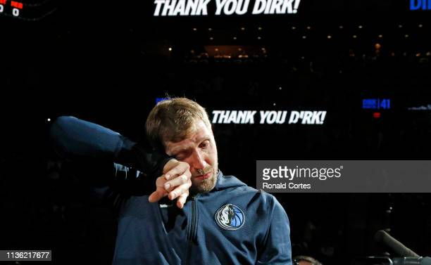 Dirk Nowitzki of the Dallas Mavericks became emotional during video of his highlights before the game against the San Antonio Spurs at ATT Center on...