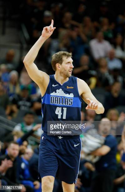 Dirk Nowitzki of the Dallas Mavericks celebrates a score against the San Antonio Spurs at ATT Center on April 10 2019 in San Antonio Texas NOTE TO...