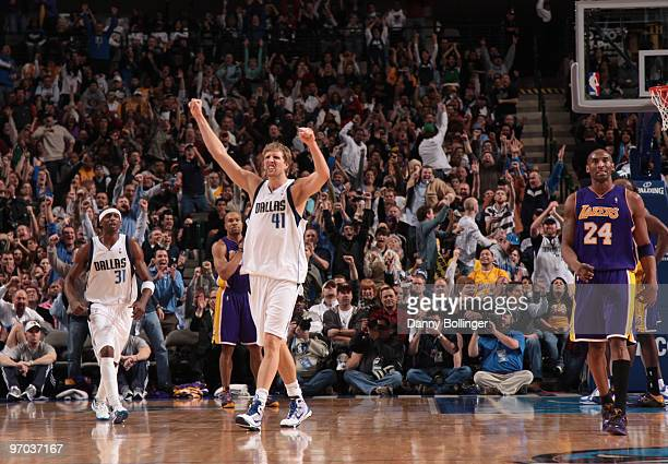 Dirk Nowitzki of the Dallas Mavericks celebrates a win against the Los Angeles Lakers during a game at the American Airlines Center on February 24...