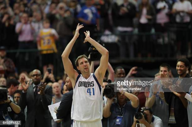 Dirk Nowitzki of the Dallas Mavericks celebrates after scoring his 30000 career point in the second quarter against the Los Angeles Lakers at...