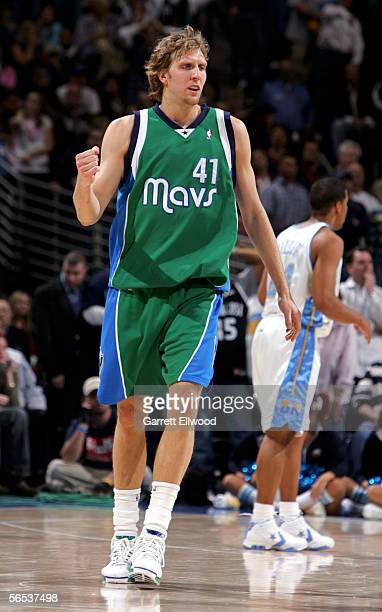 Dirk Nowitzki of the Dallas Mavericks celebrates against the Denver Nuggets on January 6 2006 at the Pepsi Center in Denver Colorado The Mavs won the...
