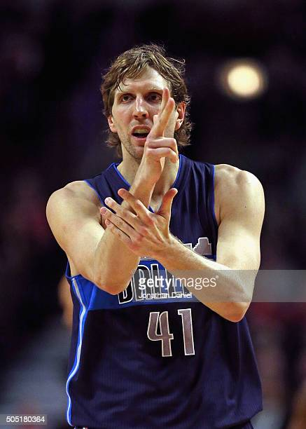 Dirk Nowitzki of the Dallas Mavericks celebrates hitting a three point shot in the 4th quarter against the Chicago Bulls at the United Center on...