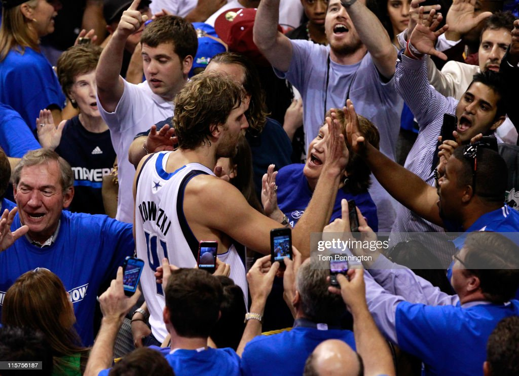 Dirk Nowitzki #41 of the Dallas Mavericks celebrates with fans after the won 112-103 against the Miami Heat in Game Five of the 2011 NBA Finals at American Airlines Center on June 9, 2011 in Dallas, Texas.