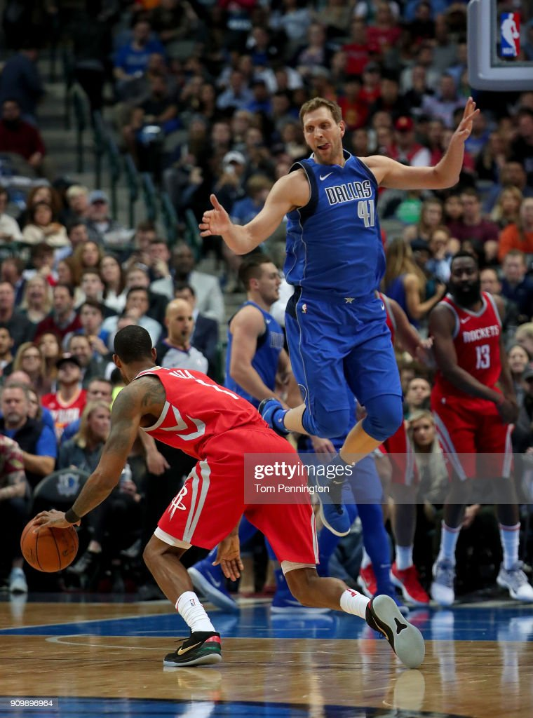 Dirk Nowitzki #41 of the Dallas Mavericks covers Trevor Ariza #1 of the Houston Rockets in the first half at American Airlines Center on January 24, 2018 in Dallas, Texas.
