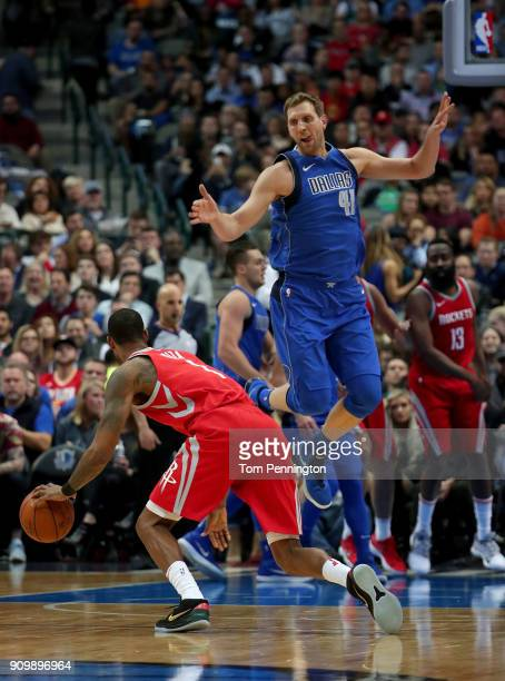 Dirk Nowitzki of the Dallas Mavericks covers Trevor Ariza of the Houston Rockets in the first half at American Airlines Center on January 24 2018 in...