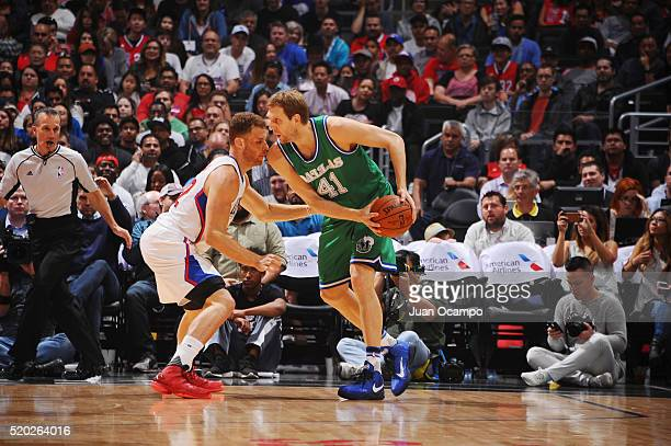 Dirk Nowitzki of the Dallas Mavericks defends the ball against the Los Angeles Clippers during the game on April 10 2016 at STAPLES Center in Los...